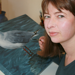 The artist painting in her studio